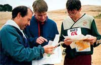 Steve Gregg, Tapio Karras, and Werner Haag compare split times on Red at the Morgan Territory A-meet, Oct. 2001 (Photo: Judy Koehler)