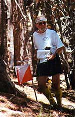Joe Scarborough checks his escape route on the Green course at Mt. Pinos, June 2001 (Photo: Joel Thompson, LAOC)
